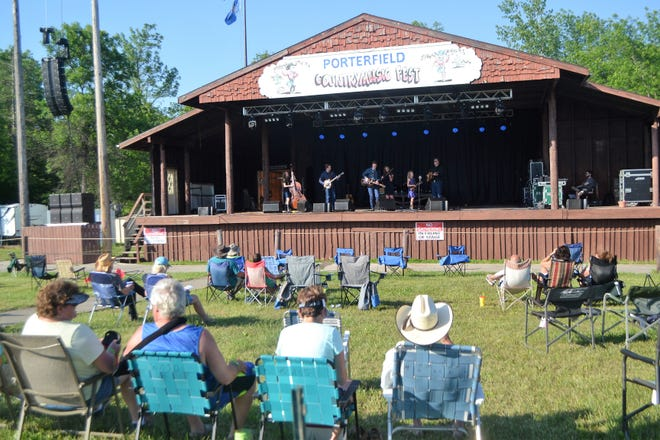 The Paul Family Bluegrass Band from the Upper Peninsula performs early Thursday evening at the Porterfield Country Music Festival at Green's Green Acres Campground west of Marinette on June 18, 2020. The annual festival continues through Sunday.
