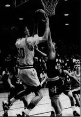 Belt forward Powell Becker (50) coasts in for two of his 28 points in an 8C district game against Highwood in 1995.