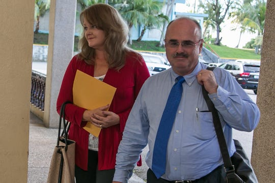 In this July 2013 file photo, fired Port Authority of Guam marketing manager Bernadette Meno, left, makes her way into a Civil Service Commission meeting, along with her attorney, Curtis Van De Veld.