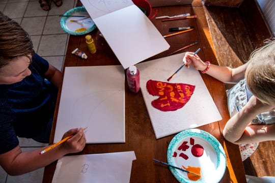 Maddox and Madelyn Brunet sit at the kitchen table in Jackson, Tenn., painting and drawling a new canvas for their baby brother, Macklin  who is soon to be born and move with the family at Jackson, Tenn.