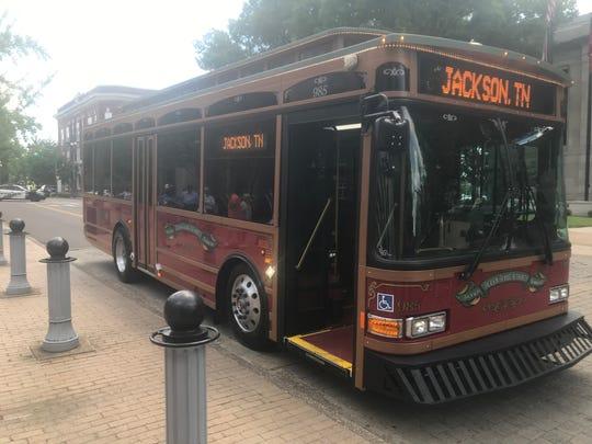 Jackson Transit Authority's new trolley-like bus pulls up to Jackson City Hall on Thursday.