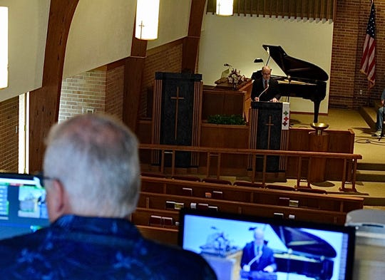 Dwayne Miller, left, oversees the livestreaming of Pastor Steve Rath's sermon at Christ United Methodist Church in Baltimore. The church is one of several local churches that has been streaming services after the state health department's shelter in place order during the coronavirus pandemic.