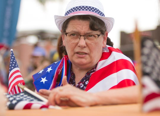 Catherine Basala, who immigrated to the United States recently, attends the Stand Up Michigan Freedom Rally in Brighton Friday, June 19, 2020.