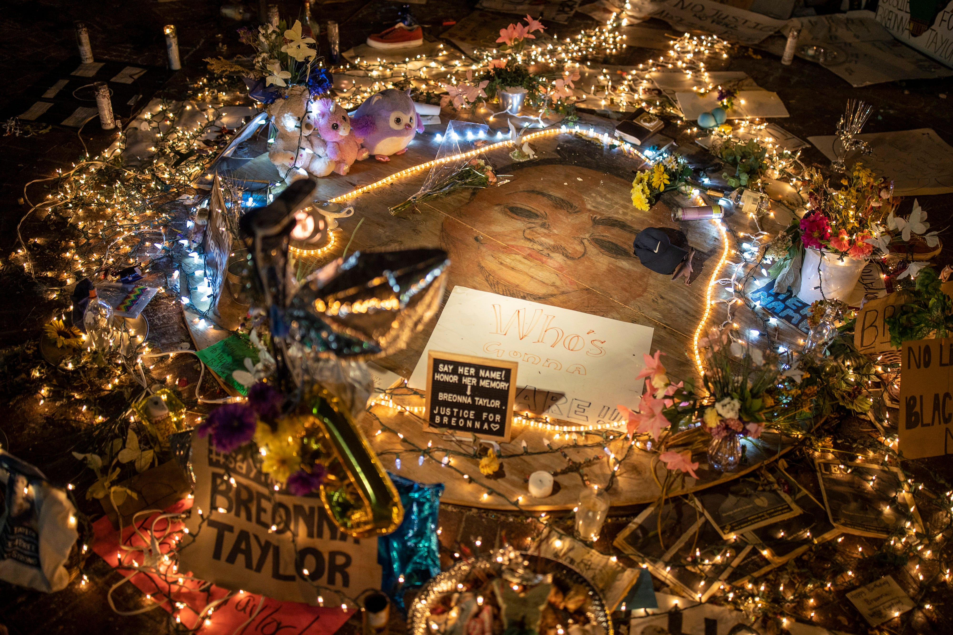 A portrait of Breonna Taylor is surrounded by tributes and lights in downtown Louisville on Thursday evening. June 18, 2020