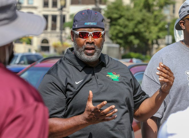 Ty Scroggins, a coach at DeSales, was one of 16 high school football coaches who gathered at the corner of 6th and Jefferson Streets on Friday, June 19, 2020.  The coaches are part of a Minority Coaches Association of Kentucky who decided to come together on Juneteenth to march to Jefferson Square and around downtown Louisville.