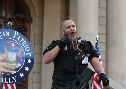 """Phil Robinson of the Michigan Liberty Militia speaks during the """"American Patriot Rally: A well-regulated militia"""" at the Michigan State Capitol in downtown Lansing Thursday evening, June 18, 2020.  [MATTHEW DAE SMITH/USA Today Network]"""
