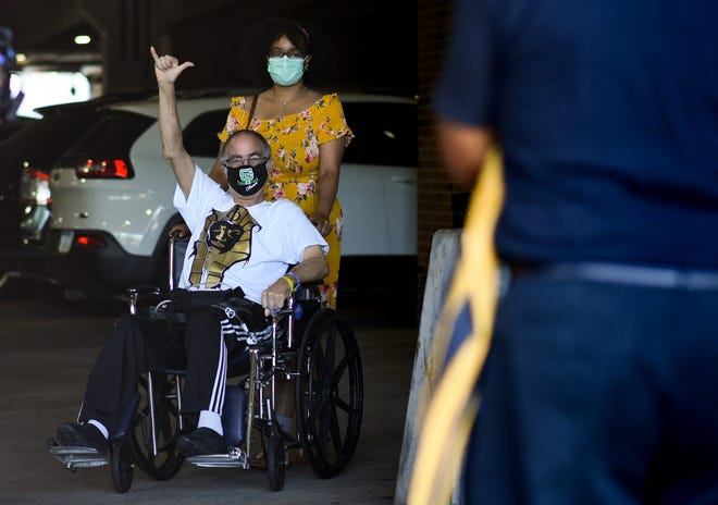 Ernie Cabule of Lansing greets friends and family Friday, June 19, 2020, after being released from Sparrow Hospital in Lansing after a 90-day battle with COVID-19.