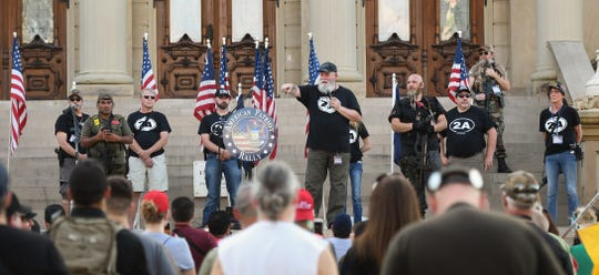 """""""Trucker Randy"""" Bishop speaks during the """"American Patriot Rally"""" at the Michigan State Capitol in downtown Lansing Thursday evening, June 18, 2020.  [MATTHEW DAE SMITH/USA Today Network]"""