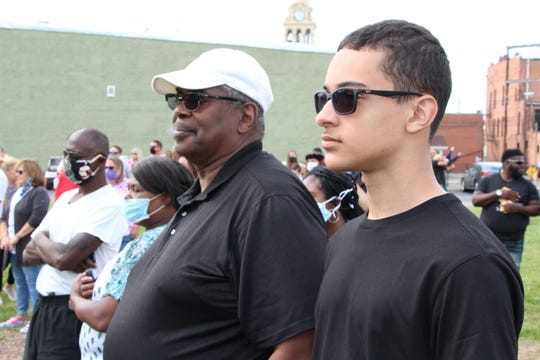 Ray Macklin, left, and his son, Jamien, listen to speakers during the Black Lives Matter Rally 4 Justice on Saturday, June 13, 2020, at Founders Park in downtown Marion. Macklin said he took his son to the rally because he wanted him to understand that he has his own voice and opinions and can help make positive changes in society.