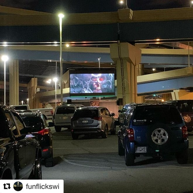 """People stay in their cars while watching """"The Goonies"""" at the first Parking Lot Theatre event, held in a lot on St. Paul Avenue in the Menomonee Valley."""