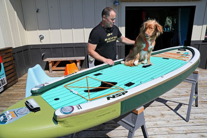 Cris Rosario's dog Jet is at home on a paddleboard.