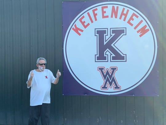 Keifenheim gives his new banner the thumbs up at West Monroe's Shelby Aulds Field on Thursday night.