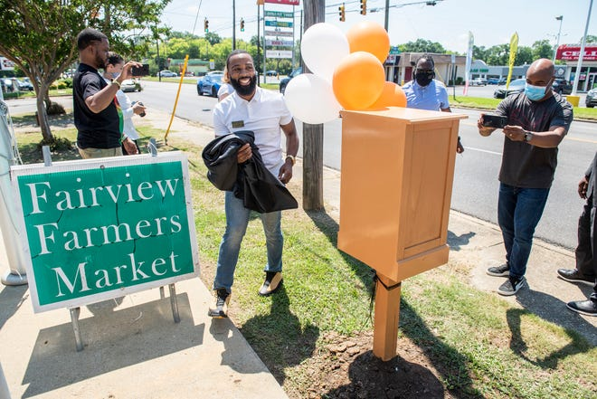 Jeremy Kelly reveals a new little library outside the Fairview Farmers Market in Montgomery, Ala., on Friday, June 19, 2020.