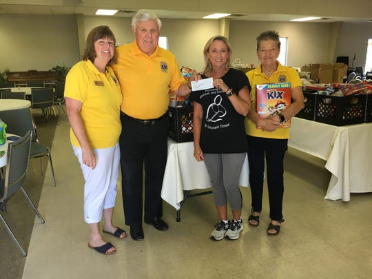 In early June, the Pike Road Lions Club donated $1,200 to the Woodland UMC Food Pantry. From left to right; Wendy Blackmon, Jimmy Lee, Stacy Dickinson, chairman of the food pantry, and Kitty Simpson.