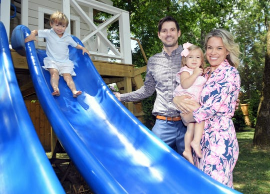 """Sara Jo Walker and her husband, Ryan, play with their children Jack, 3, and Ivy, 18 months old, in their Nashville backyard June 19, 2020. Walker wrote a children's book on face masks. It's currently No. 2 on Amazon's """"New Releases in Children's Safety"""" book list."""