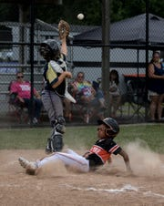 Cordez Felciano of Central Ohio Fire slides safely into home in the first game of the Nations Ohio State Championship at Mound City in Newark. Central Ohio Fire beat Vikings Elite and will play in the next round.