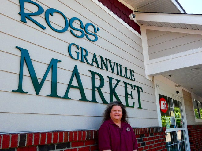Tracy Sandbrink does a little bit of everything at Ross' Granville Market from cashier, stock and carry-out.