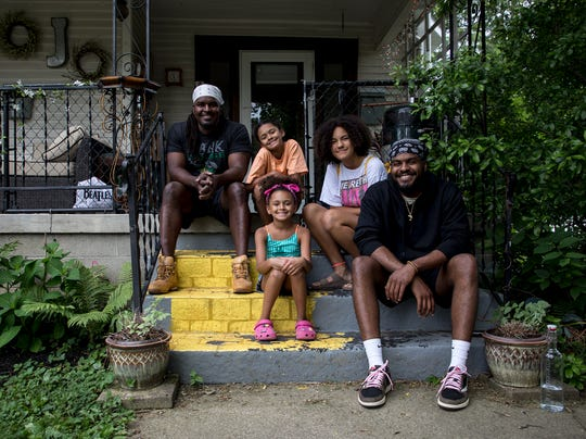 Rese Jhordan (far left) sits on his front porch with his four children, Marley, 10, Bella, 15, Dontaveus, 28, and Joplynn, 9.
