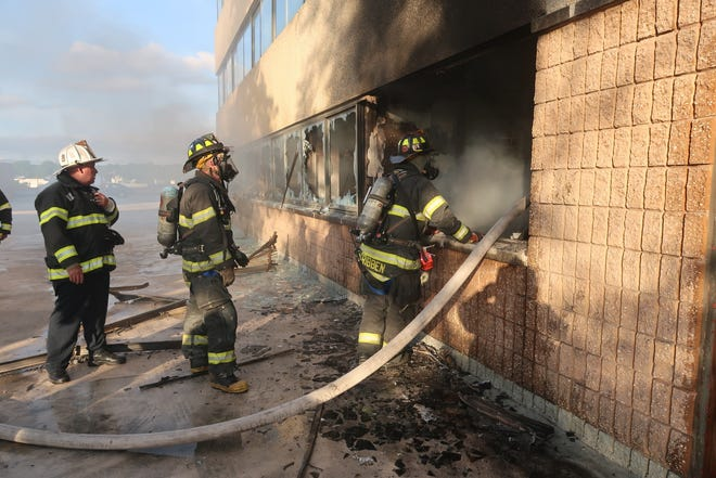 A two-alarm fire burned in the first floor of a six story office building on Hudson Street.