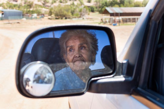 At Oak Springs on the Navajo Reservation in Arizona, Jean Wilson waits in line in her truck to pick up food distributed by the Southwest Indian Foundation in Gallup.
