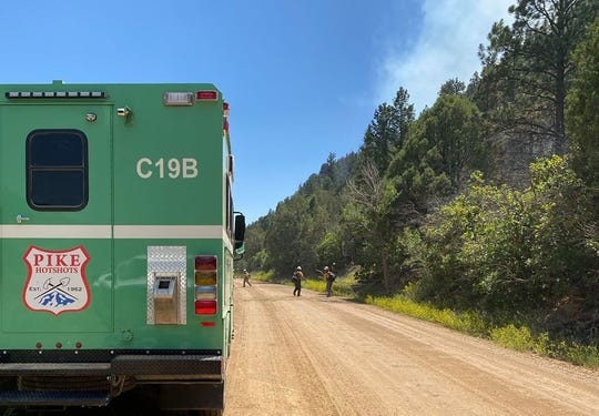 Crews work to create fire lines to contain the East Canyon Fire.
