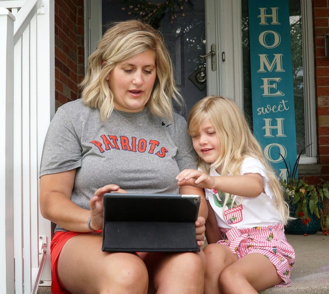 """Livonia Franklin special education teacher Kacie McCullough is looking forward to getting back to in-class teaching this fall. She's had to spend a lot of time in the past few months working with her soon-to-be first grader Harper, 5, and """"remote learning"""" using tablet computers."""