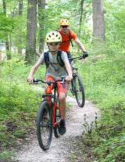 Finn Banas and his father Jon hit the Bell Branch Loop trail at the now-opened Seven Mile Loop hiking and biking trail on June 19, 2020. The trails, located on the former property of the Northville Psychiatric Hospital grounds, were officially opened that day by Northville Township.