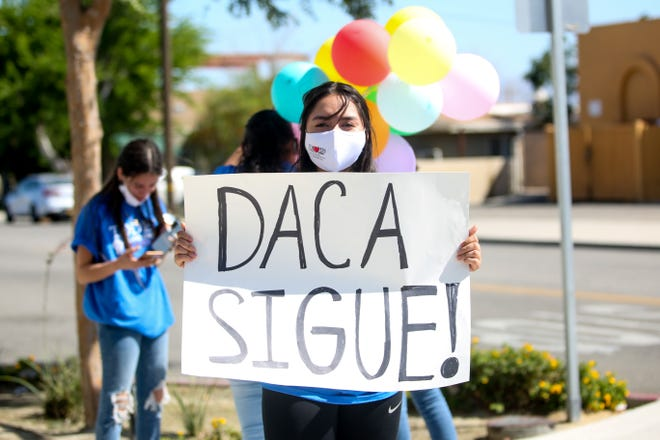 A celebration takes place outside of TODEC Legal Center in Coachella, Calif. honoring the Supreme Court decision to block the Trump administration from ending the Deferred Action for Childhood Arrivals program, which allows nearly 650,000 young, undocumented immigrants to live and work in the United States without fear of deportation on Thursday, June 18, 2020.
