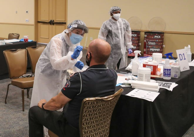 A Brio Clinical employee administers a Covid-19 test to a Fantasy Springs Resort Casino employee in Indio, June 19, 2020.