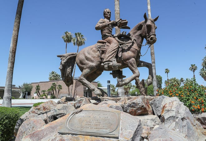 A statue of longtime Palm Springs mayor Frank Bogert sits in front of Palm Springs City Hall, June 18, 2020.