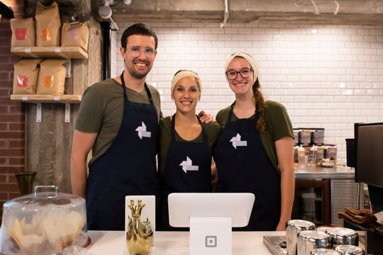 Ikigai Coffee owner Stasha van Niekerk (center) poses for a portrait with her husband, Marcel, and manager, Miriam Weber, on Wednesday, June 17, 2020.