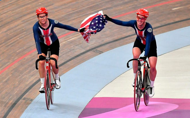 Christina Birch, right, of Gilbert and Kimberly Geist after winning the Madison track cycling race at the 2019 Pan American Games in Lima, Peru.