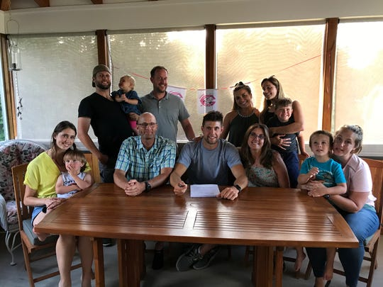 New Paltz native Stevie Branche is surrounded by family as he signs a minor-league contract with the Cincinnati Reds. The pitcher agreed on Sunday to join the organization.