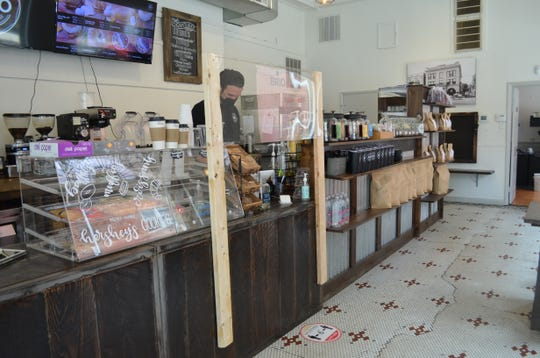Brio Coffeeshop in Waynesboro installed shields between staff and customers. Michael Hills, a barista at Brio, said they weren't too busy on Friday, but expects a crowd on Saturday.