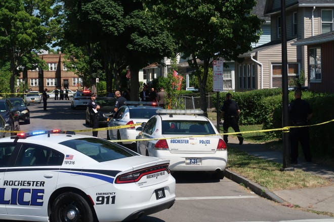 RPD vehicles at the scene of a fatal shooting on Bardin St. on Friday June 19, 2020