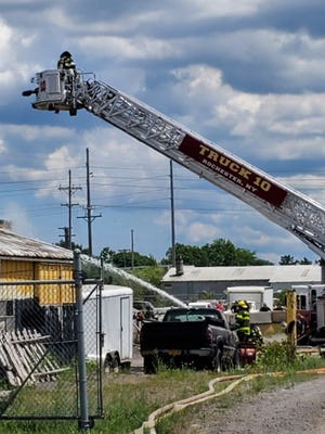 The Rochester Fire Department on scene of a structure fire on McKee Street in the city on June 19, 2020.