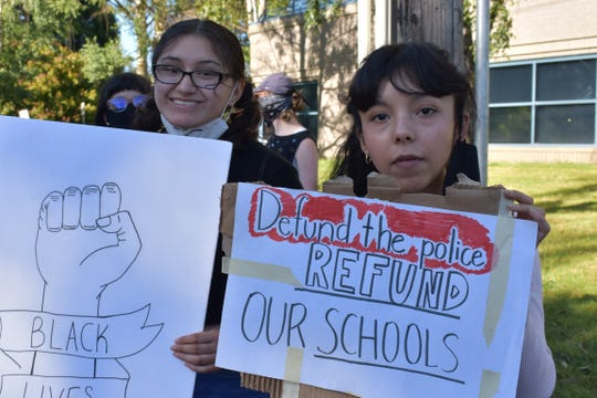 Sara Juarez (left), 17, and Grecia Gomez, 16, of Salem, participate in the Education Over Policing rally outside the Salem Keizer Public Schools building on Lancaster Drive on Thursday, June 18, 2020. The rally, organized by Latinos Unidos Siempre, calls on the school district to divest from school resource officers.