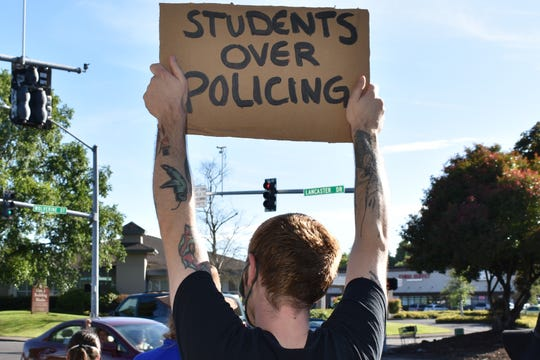About 80 protesters attended the Education Over Policing rally outside the Salem Keizer Public Schools building on Lancaster Drive on Thursday, June 18, 2020. The rally, organized by Latinos Unidos Siempre, calls on the school district to divest from school resource officers.
