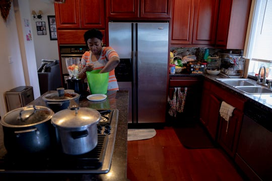 Olajumoke Elkanah – Ola for short – prepares vegetables for a catering order in her kitchen, in Salem, Oregon, on Wednesday, June 17, 2020. If she's cooking for her family or for her catering business, Elkanah prefers to cook in the early morning before her family wakes up.