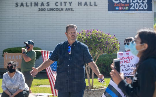 Gerard Ross, a retired police officer, speaks to a group of pro law-enforcement protesters during the MC Blue Rally held outside of city hall in Salinas, Calif., on Thursday, June 18, 2020.