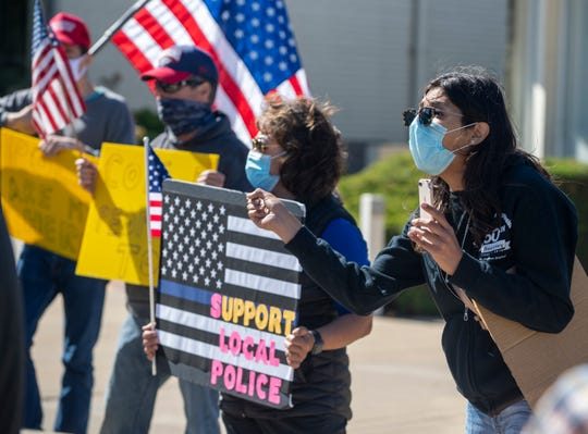 Samantha Varela, voices her opposition regarding defunding the police amid pro law-enforcement protestors in Salinas, Calif., on Thursday, June 18, 2020.