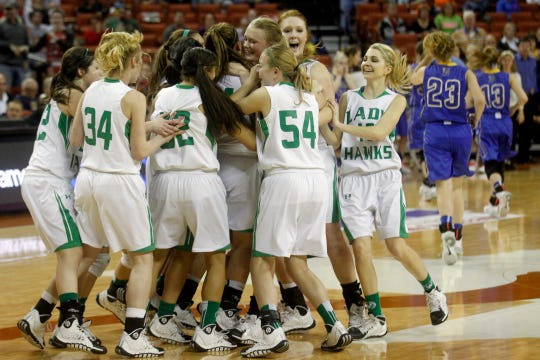 The Wall High School girls basketball team celebrates after a 48-44 win over Brock in the Class 2A state championship in Austin on March 1, 2014.