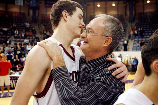 Bronte High School basketball coach Rocky Rawls hugs his son, Dakota, after their 62-58 win against Italy in the regional final at Abilene Christian University on March 6, 2010.