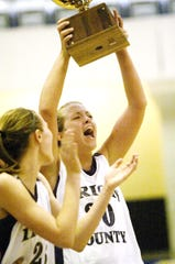 Irion County High School senior Ashley Heflin celebrates with the regional quarterfinal playoff trophy after the Lady Hornets pulled off a stunning rally in the final minutes for a 49-47 win over Meridian in 2010.