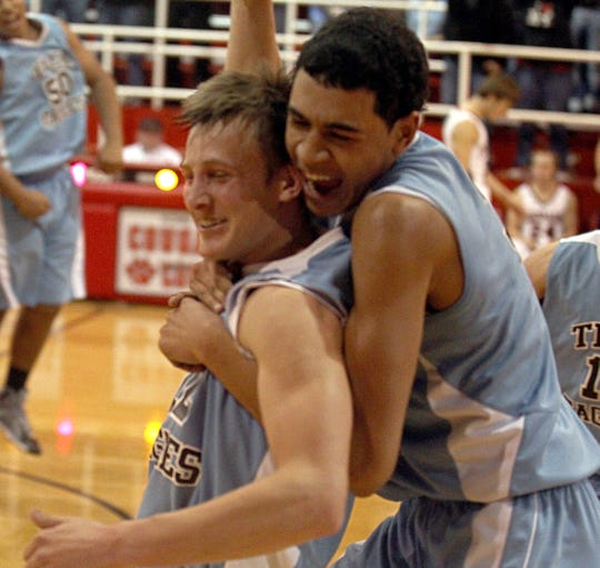 Texas Leaderships Charter Academy's Haze Wood (left) and Trey Mayberry celebrate after beating Christoval High School in a district game Feb. 12, 2014. Wood hit a layup at the buzzer for the win.