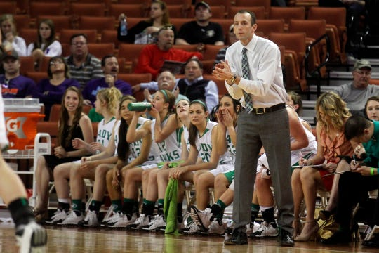 Wall High School head basketball coach Tate Lombard encourages his team from the sideline during the 2014 state final against Brock.