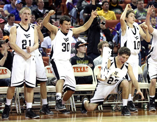 Water Valley High School's  bench celebrates during their 1A Division II state championship win over Laneville at the Frank Erwin Center in Austin on March 8, 2014.