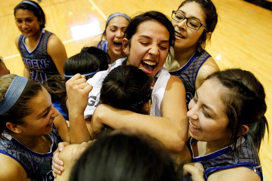The Lake View Maidens rush the floor after a 64-51 win over Amarillo Palo Duro in a Class 5A bidistrict playoff game Feb. 17, 2015.