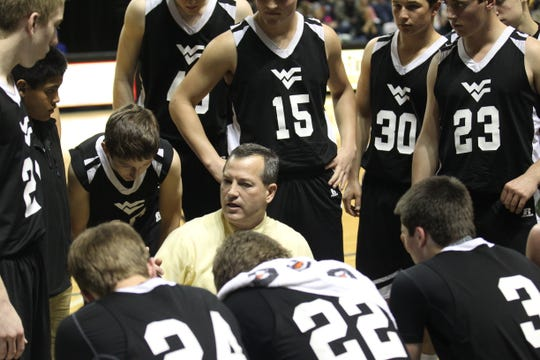 Water Valley High School head coach Andy Copley talks to his players during their regional quarterfinal playoff game against Bronte at the Junell Center in San Angelo on Feb. 25, 2014.
