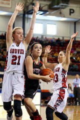 Christoval High School's Kameron Wike goes up for a shot under the basket in a Region I-2A semifinal game against Gruver at South Plains College in Levelland on Feb. 27, 2015. Christoval lost 48-43 in double overtime to end its season with a 34-1 record.